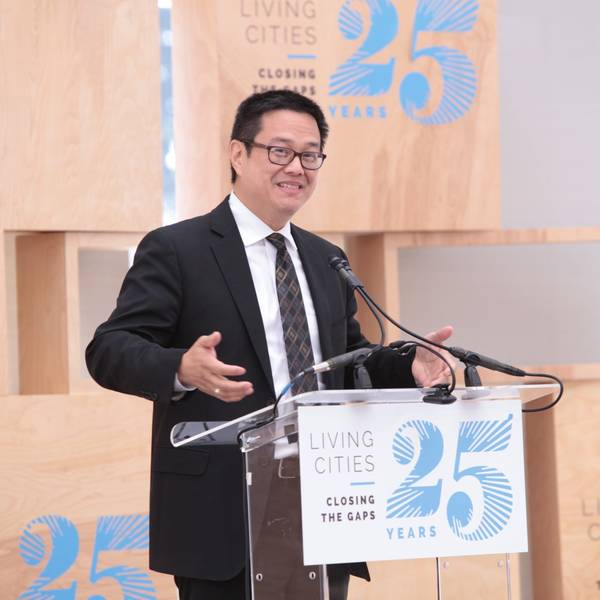 Don Chen speaks at a podium at LC's 25th Anniversary.