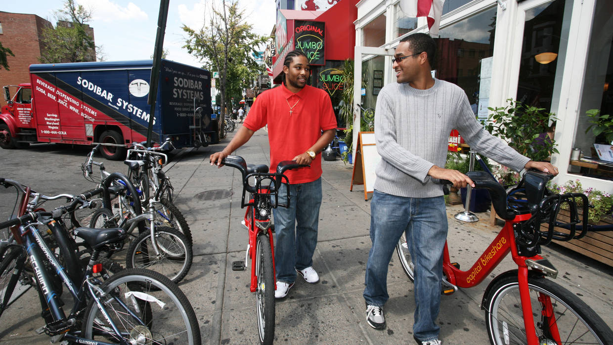 Two DC residents use the Capital Bikeshare cycles.
