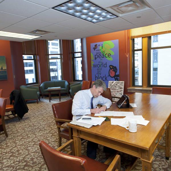RT Rybak Working in his office