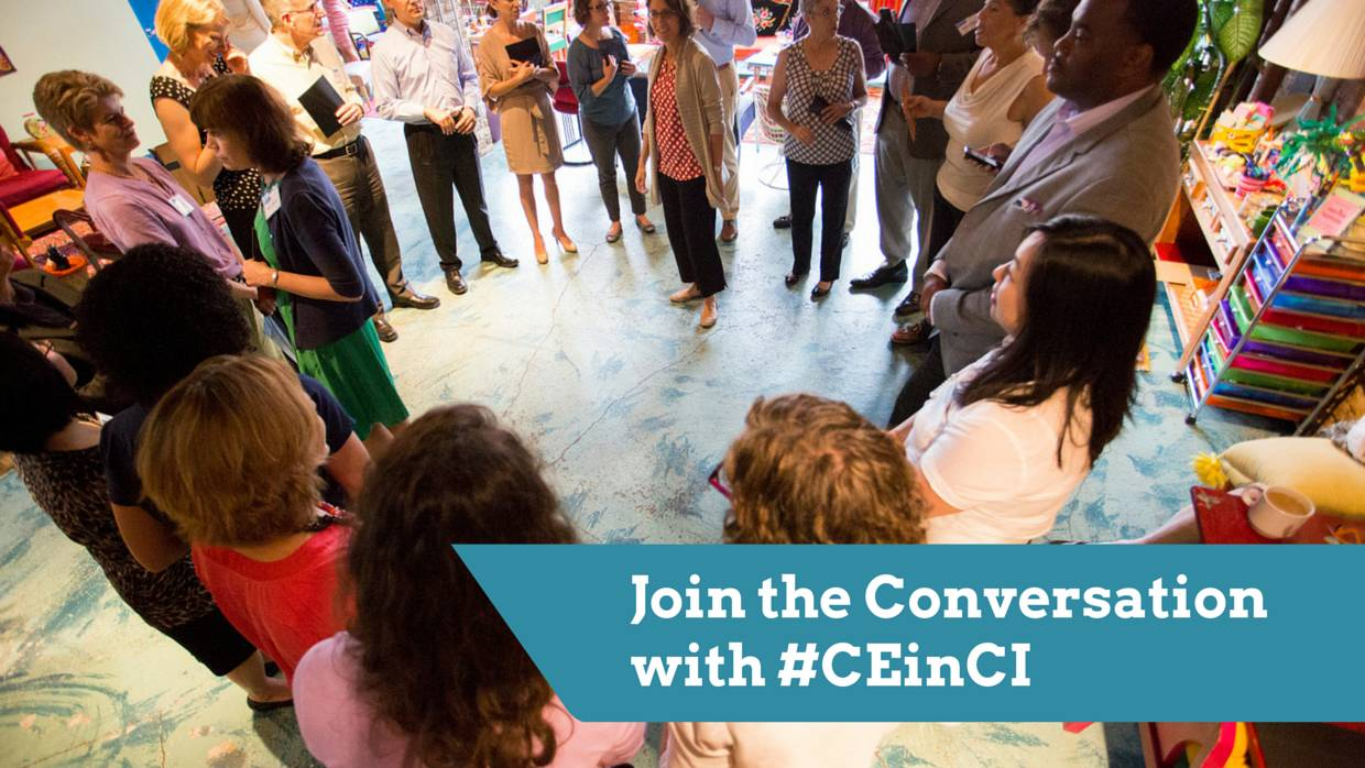 People standing in a circle join a conversation on community engagement. You can join in our conversation on social media with #CEinCI.