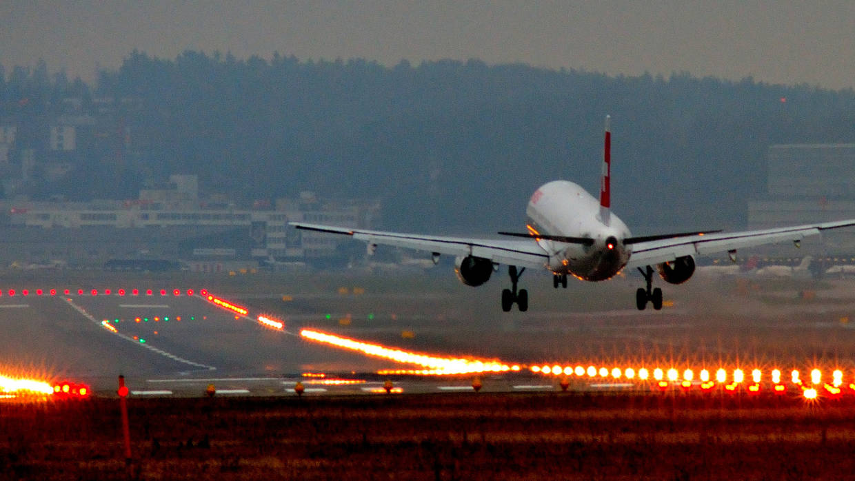 A Plane lands in an airport near Zurich, from Flickr