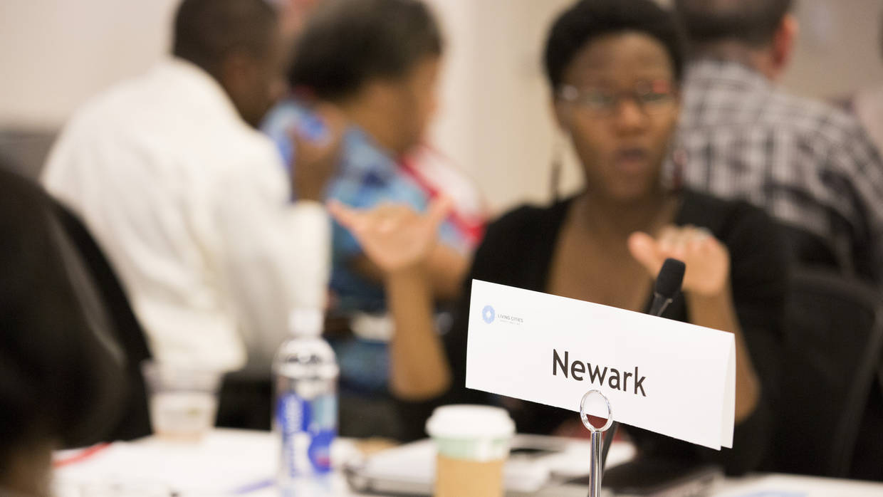 The Newark Table at the June 2015 Integration Initiative Learning Community, in the background, Initiative Director Monique Baptiste-Good