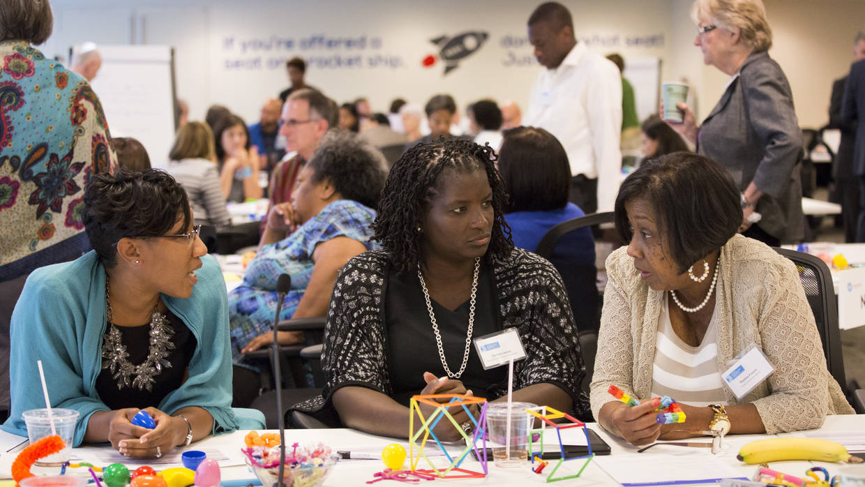 Participants in the Integration Initiative June Learning Community engage in conversation with their peers.