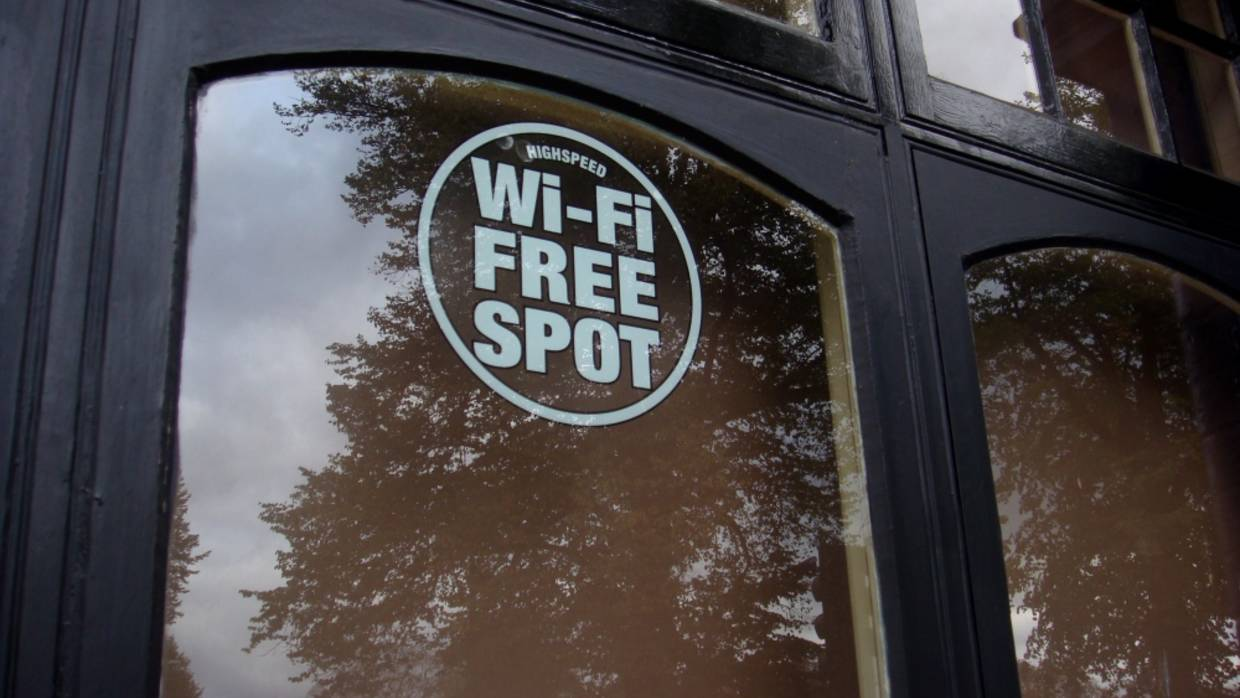 A Wifi Hot Spot Sign on a Door