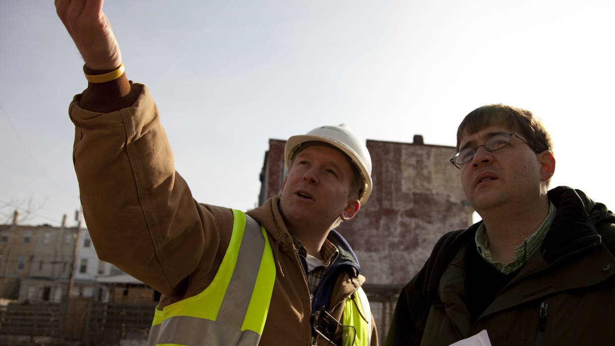 Two men discuss redevelopment plans in Baltimore, MD