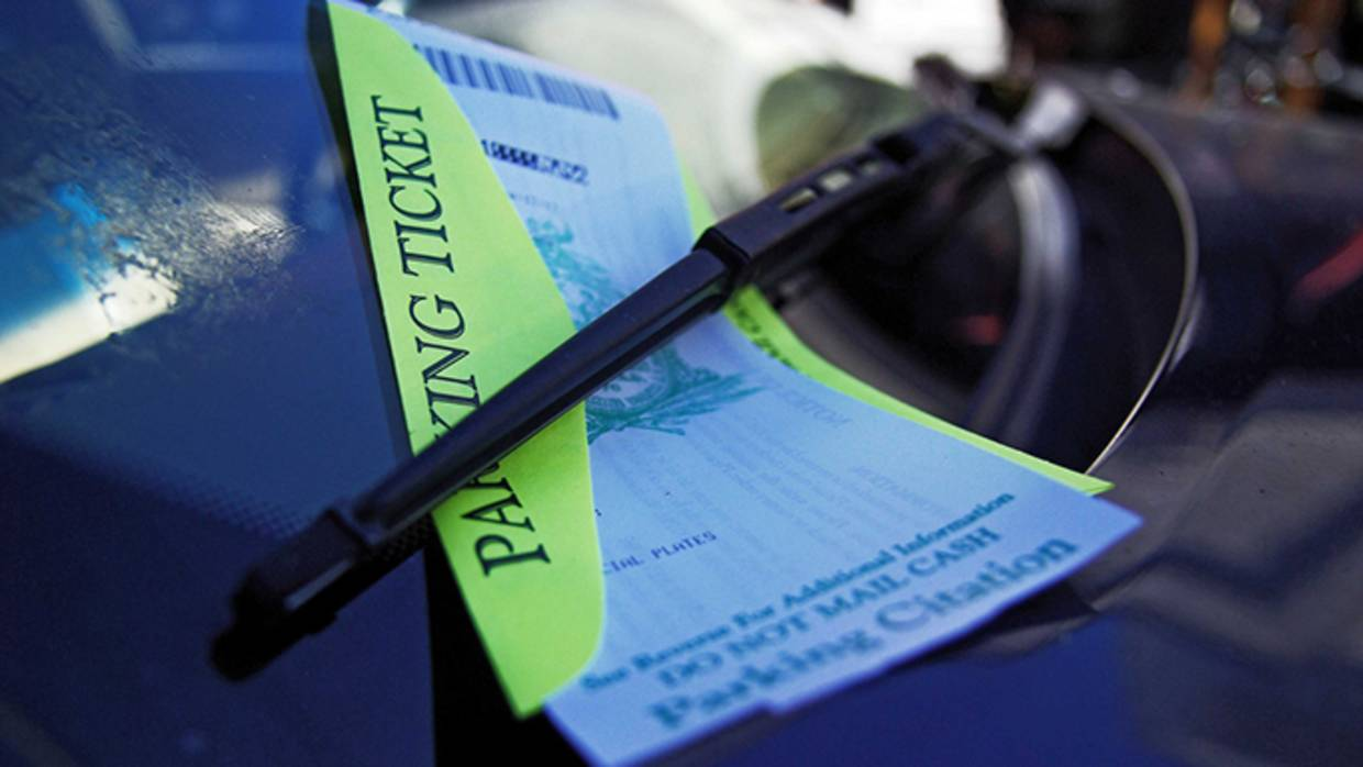 Parking ticket on the windshield of a car.