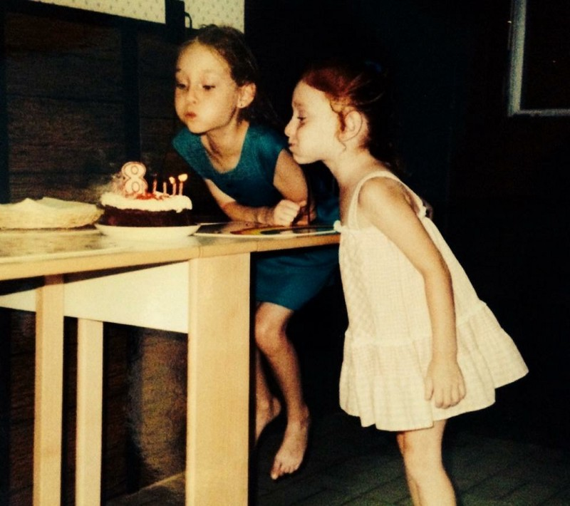 The author as a child at a birthday party, blowing out candles.