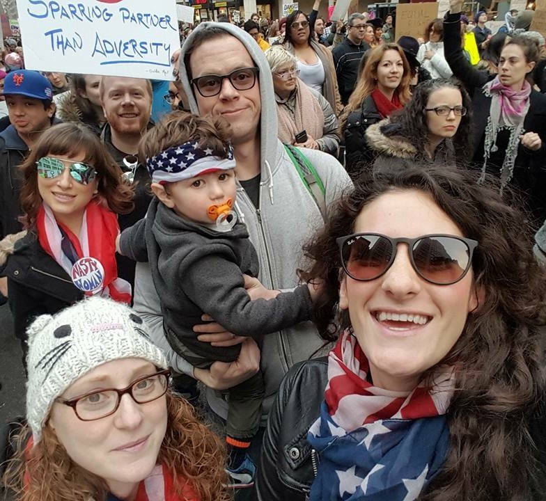 The author as an adult at the Women's March in 2017.